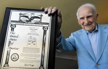 SANTA MONICA, CA-JUNE 4, 2014:  Simon Ramo, age 101, the father of the U.S. ICBM program, who has become the oldest person to get a patent,  is photographed at his home in Santa Monica on June 4, 2014.  He is holding a plaque that shows the first page of his patent that was granted to him on December 10, 2013.  The patent is for method and apparatus for interactive, computer-based, automatically adaptable learning.  Ramo was 100 years old when the patent was granted.  (Mel Melcon/Los Angeles Times)